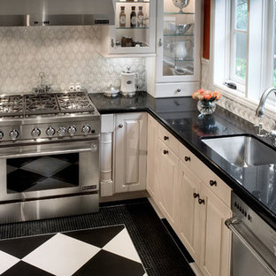 Large traditional eat-in kitchen photos - Inspiration for a large timeless l-shaped porcelain tile eat-in kitchen remodel in Dallas with a single-bowl sink, beaded inset cabinets, white cabinets, granite countertops, white backsplash, stone tile backsplash, stainless steel appliances and no island