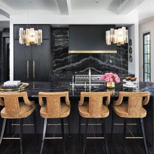 Inspiration for a mediterranean kitchen in Minneapolis with an undermount sink, flat-panel cabinets, dark wood cabinets, black splashback, stainless steel appliances, dark hardwood floors, with island and brown floor.