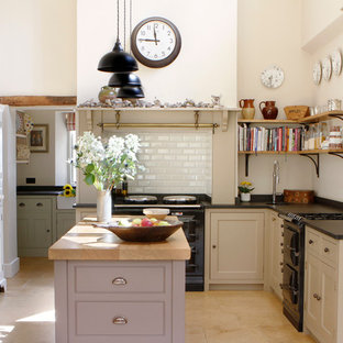 Inspiration for a country kitchen in West Midlands with an integrated sink, shaker cabinets, granite benchtops, white splashback, subway tile splashback and travertine floors.