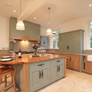 Design ideas for a traditional l-shaped kitchen/diner in Hampshire with a double-bowl sink, shaker cabinets, green cabinets, engineered stone countertops, stone slab splashback and beige splashback.