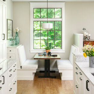 Inspiration for a large traditional l-shaped open plan kitchen in Detroit with an undermount sink, shaker cabinets, white cabinets, grey splashback, stone tile splashback, stainless steel appliances, medium hardwood floors, with island, brown floor, grey benchtop, coffered and quartz benchtops.