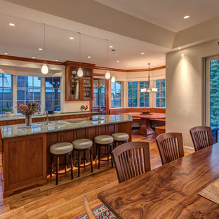 Inspiration for a large transitional l-shaped open plan kitchen in Other with an undermount sink, recessed-panel cabinets, brown cabinets, medium hardwood floors, with island, brown floor and green benchtop.