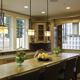 Craftsman kitchen designs - Kitchen - craftsman kitchen idea in Seattle with glass-front cabinets and wood countertops