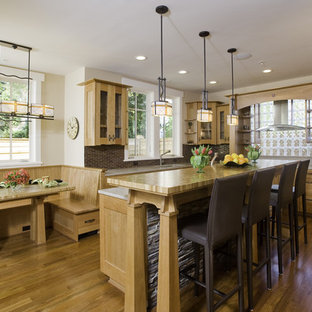 Inspiration for an arts and crafts kitchen in Seattle with glass-front cabinets.