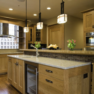 Photo of a traditional kitchen in Seattle with glass-front cabinets and slate splashback.