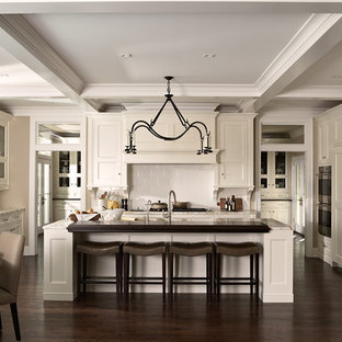 Inspiration for a large transitional u-shaped dark wood floor open concept kitchen remodel in Minneapolis with a single-bowl sink, flat-panel cabinets, white cabinets, marble countertops, white backsplash, ceramic backsplash, paneled appliances and an island