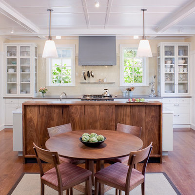 Example of a transitional galley eat-in kitchen design in San Francisco with glass-front cabinets, white cabinets and beige backsplash