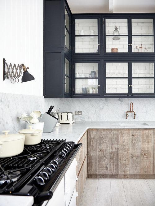 Scandinavian kitchen inspiration - Inspiration for a scandinavian l-shaped  light wood floor kitchen remodel