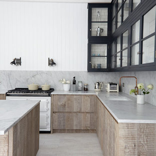 Inspiration for a scandinavian kitchen in London with an undermount sink, glass-front cabinets, white appliances, with island and grey splashback.