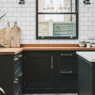 Industrial Dark Green Kitchen with a Vintage Twist