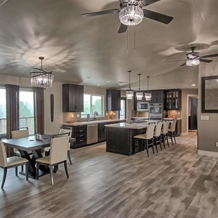 Inspiration for a mid-sized industrial single-wall eat-in kitchen in Sacramento with a double-bowl sink, shaker cabinets, dark wood cabinets, beige splashback, stainless steel appliances, with island, multi-coloured floor, beige benchtop, granite benchtops and dark hardwood floors.