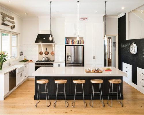 Example of a large classic l-shaped open concept kitchen design in ...