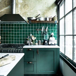 Mid-sized industrial l-shaped eat-in kitchen in Columbus with an undermount sink, raised-panel cabinets, green cabinets, quartz benchtops, green splashback, ceramic splashback, stainless steel appliances, ceramic floors, with island, multi-coloured floor and white benchtop.