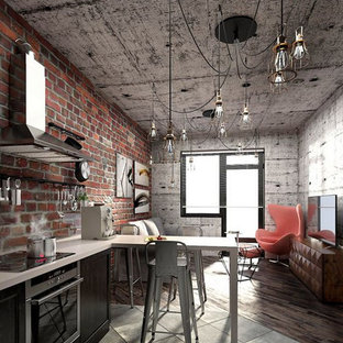Design ideas for a small urban single-wall kitchen/diner in Columbus with a submerged sink, recessed-panel cabinets, black cabinets, engineered stone countertops, brown splashback, brick splashback, stainless steel appliances, cement flooring, a breakfast bar, grey floors and white worktops.