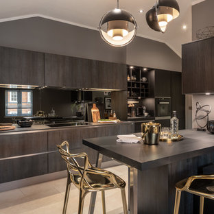 Design ideas for a contemporary l-shaped kitchen in Other with flat-panel cabinets, brown cabinets, mirror splashback, a breakfast bar, beige floors and grey worktops.
