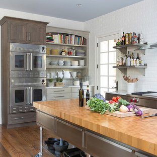 Industrial Kitchen with Stainless Steel Island and Subway Tile