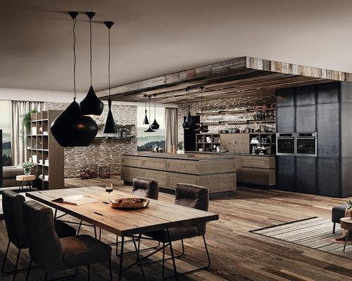 Cuisine ouverte industrielle avec des portes de placard en for Cuisine type industrielle