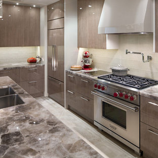 Inspiration for a mid-sized contemporary l-shaped eat-in kitchen in Calgary with an undermount sink, flat-panel cabinets, grey cabinets, onyx benchtops, beige splashback, stainless steel appliances, travertine floors, with island, beige floor and brown benchtop.