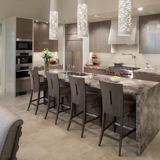 Design ideas for a mid-sized contemporary l-shaped eat-in kitchen in Calgary with an undermount sink, flat-panel cabinets, grey cabinets, beige splashback, stainless steel appliances, with island, onyx benchtops, travertine floors, beige floor and brown benchtop.