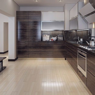Small contemporary l-shaped kitchen pantry in San Francisco with flat-panel cabinets, dark wood cabinets, granite worktops, black splashback and black worktops.