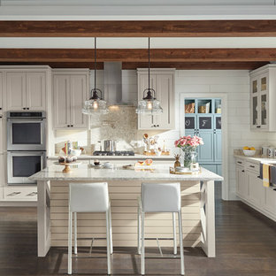 Inspiration for a mid-sized country u-shaped separate kitchen in Other with a farmhouse sink, recessed-panel cabinets, beige cabinets, granite benchtops, white splashback, timber splashback, stainless steel appliances, dark hardwood floors, with island, brown floor and beige benchtop.