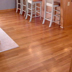 """Inspiring Ideas from Prodigy Hardwood Interiors - Pictured is a 3/4"""" x 3 1/2"""" Rift & Quartered White Oak Select Grade, Prefinished Neutral / Urethane."""