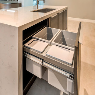 Design ideas for a medium sized contemporary l-shaped kitchen pantry in San Francisco with a single-bowl sink, flat-panel cabinets, dark wood cabinets, engineered stone countertops, grey splashback, porcelain splashback, porcelain flooring and an island.