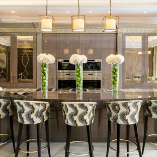 Design ideas for a large traditional single-wall kitchen in London with grey cabinets, quartz worktops, ceramic flooring, an island, beige floors, grey worktops, flat-panel cabinets, stainless steel appliances and a submerged sink.