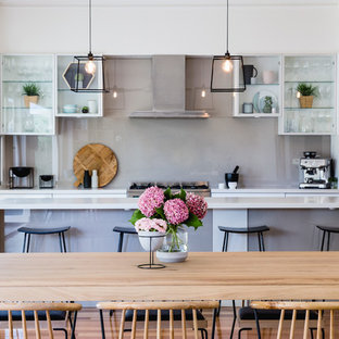 Open concept kitchen - mid-sized contemporary galley open concept kitchen idea in Melbourne with glass-front cabinets, gray backsplash, stainless steel appliances and an island
