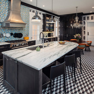 This is an example of a large eclectic l-shaped eat-in kitchen in Other with with island, an undermount sink, beaded inset cabinets, black cabinets, marble benchtops, porcelain splashback, stainless steel appliances, marble floors, multi-coloured floor, blue splashback and turquoise benchtop.