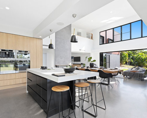 Design ideas for a large contemporary open plan kitchen in sunshine coast with light wood cabinets