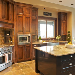 Traditional kitchen in Portland with granite benchtops and slate splashback.