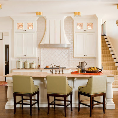 Example of a classic kitchen design in Atlanta with recessed-panel cabinets, white cabinets, white backsplash and subway tile backsplash