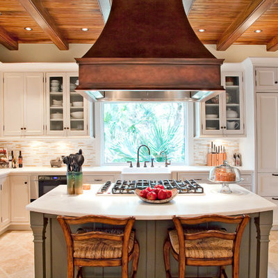 Example of a classic kitchen design in San Francisco with a farmhouse sink, recessed-panel cabinets, white cabinets, beige backsplash and matchstick tile backsplash