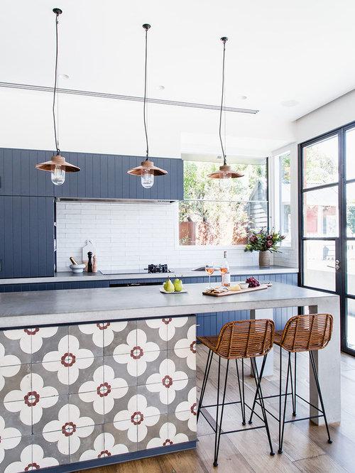 Beach Style Kitchen Photos   Example Of A Coastal Galley Light Wood Floor Kitchen  Design In