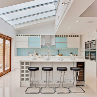 Trendy kitchen photo in Other with stainless steel appliances