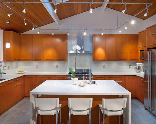 Example of a trendy u-shaped kitchen design in Vancouver with glass ...