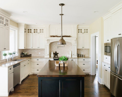Inspiration For A Transitional U Shaped Kitchen Remodel In Vancouver With  Wood Countertops