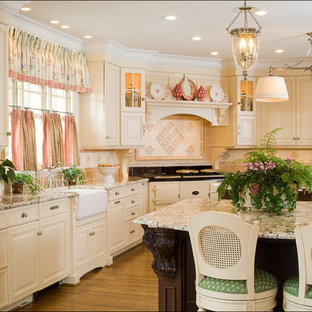 Kitchen - traditional kitchen idea in Charlotte with a farmhouse sink and granite countertops