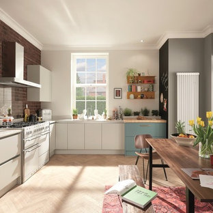 This is an example of a medium sized scandinavian l-shaped kitchen/diner in Dublin with a submerged sink, flat-panel cabinets, turquoise cabinets, quartz worktops, glass sheet splashback, white appliances, plywood flooring and no island.