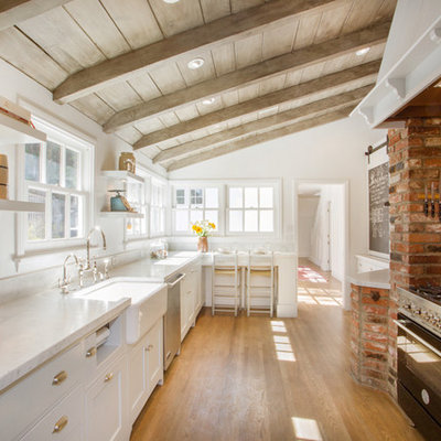 Kitchen - country medium tone wood floor kitchen idea in Los Angeles with a farmhouse sink, shaker cabinets, white cabinets, black appliances and no island