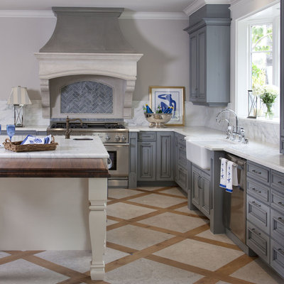 Example of a classic kitchen design in San Diego with a farmhouse sink, stainless steel appliances, raised-panel cabinets, blue cabinets and blue backsplash
