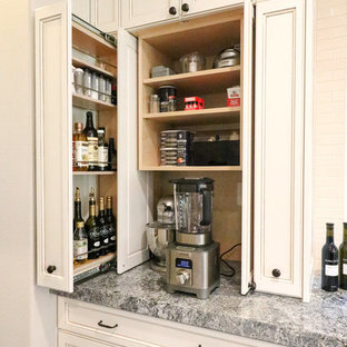 Design ideas for a traditional kitchen in Orange County with recessed-panel cabinets, white cabinets and grey worktops.