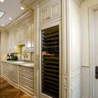 Inspiration for a timeless kitchen remodel in Orange County with marble countertops