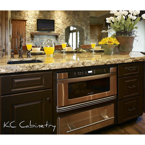 Example Of A Mountain Style Single Wall Light Wood Floor Eat In Kitchen  Design