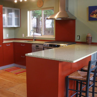 Inspiration for a mid-sized contemporary open plan kitchen in Vancouver with flat-panel cabinets, red cabinets, recycled glass benchtops, red splashback, metal splashback and light hardwood floors.
