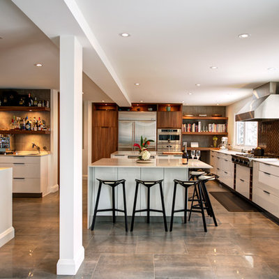 Trendy l-shaped gray floor kitchen photo in Ottawa with flat-panel cabinets, white cabinets, brown backsplash and stainless steel appliances