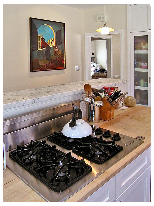midsized elegant ushaped enclosed kitchen photo in san francisco with a double