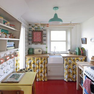 Design ideas for a small scandinavian eat-in kitchen in London with a farmhouse sink, wood benchtops, white splashback, subway tile splashback, white appliances and no island.