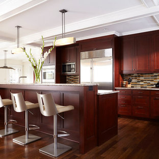 Example of a transitional brown floor kitchen design in Minneapolis with matchstick tile backsplash, stainless steel appliances, recessed-panel cabinets, dark wood cabinets and multicolored backsplash